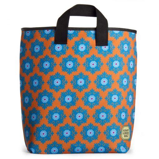 blue spring flowers on orange grocery bag