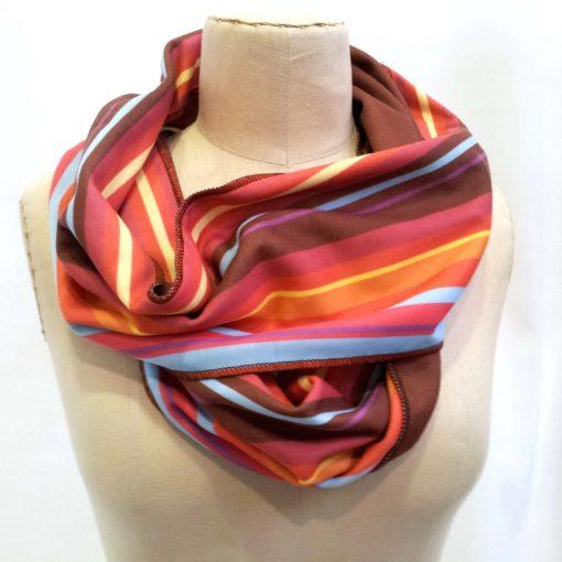 Burgundy stripe infinity scarf on mannequin
