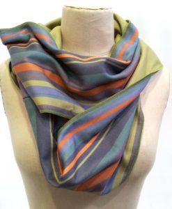Green orange and blue striped infinity scarf on mannequin