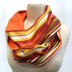 Orange striped infinity scarf on mannequin